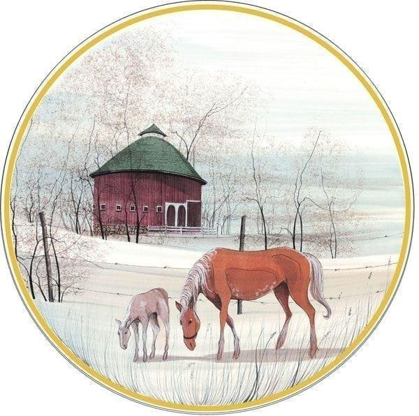 Country Meadow limited edition porcelain ornament is a wafer thin disk fired with an image by P Buckley Moss featuring a horse, colt and round burgundy barn in the background in shades of rusts and cream for the horses and soft blues, greens and white in the background.