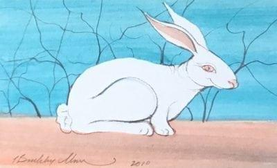 White Bunny original Watercolor Painting by P Buckley Moss exclusively at Canada Goose Gallery in Waynesville, Ohio. Fluffy white bunny, sitting at the ready for its next move. Beautiful blue background with peach colored area under the rabbit.