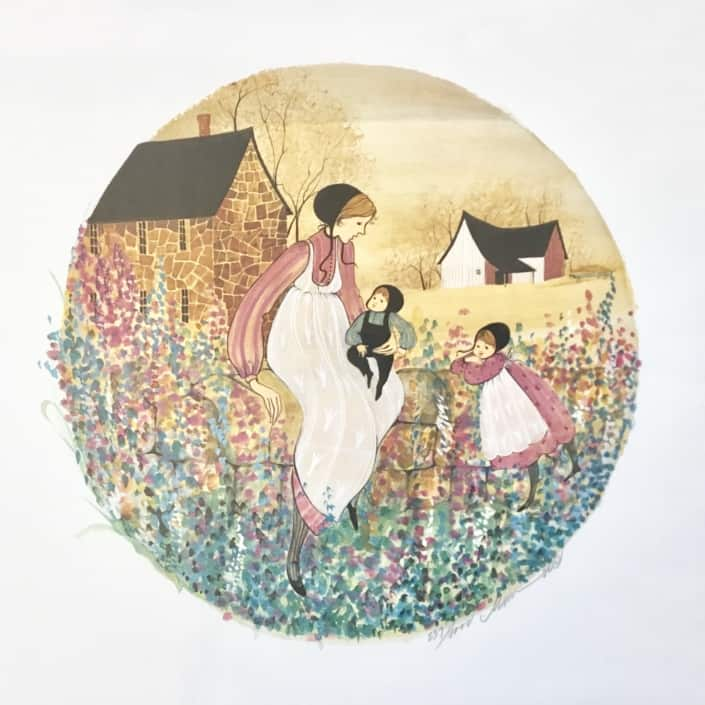 Cottage Wall limited edition print by P Buckley Moss features a mother with two children in a rural setting with barn, house sitting on a wall with a growth of flowers. Colors of blue, green, tan, cream pink and mauve and golden shades of yellow.
