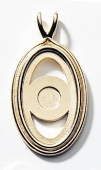 Gold metal surround with center magnet to hold porcelain oval art disks with images by P Buckley Moss. Can be worn on a chain.