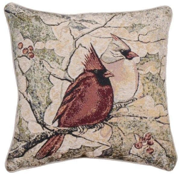 Tapestry pillow with male and female cardinals perched on a branch. Background of holly leave and branches.