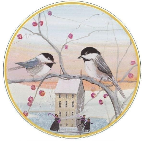 Limited edition porcelain ornament by P Buckley Moss featuring two birds on tree branches with berries in a soft background of peach and blue.