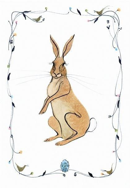 Birth of Spring is a limited edition print by P Buckley Moss featuring a loveable bunny rabbit sitting in a border of flowers.