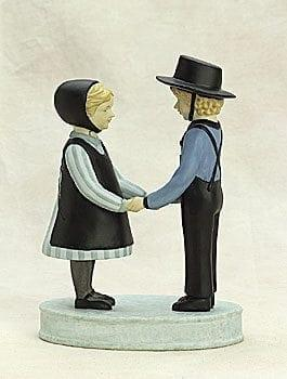 Friends Forever figurine by P Buckley Moss features a boy and a girl facing each and holding hands. Colors of soft green and aqua with black.