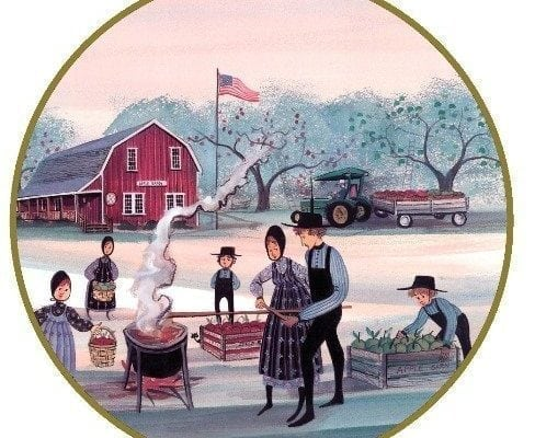 Apple Butter Makers Ornament by P Buckley Moss features a popular fall scene with the family outside making Fall apple Butter. Colors of mauve, peach, greens, blues and black.