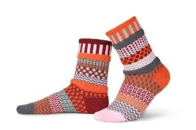 Solmate Persimmon Crew Socks in orange, pink, burgundy and gray.