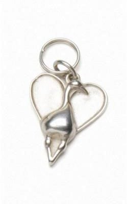 Canada Goose in a heart designed by P Buckley Moss. Sterling silver to be worn on a chain or bracelet.