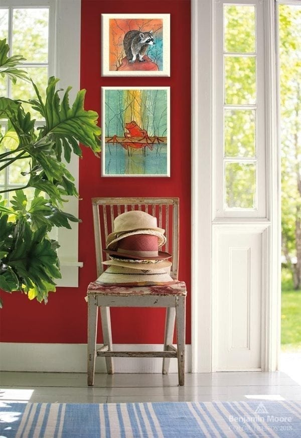 Beautiful shade of red on the walls with matching artwork to enhance the entryway area.