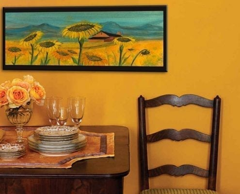 Home decor hallway with Fields of Sunshine limited edition print by P Buckley Moss in shades of marigold colors.