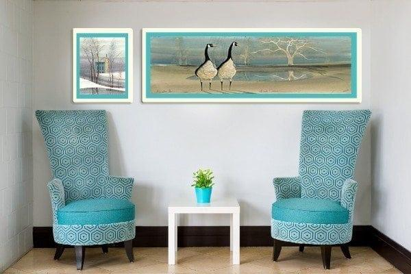 Beach Comber limited edition print is featured in this artwork. Framed in a white frame and the focal point of living space between chairs