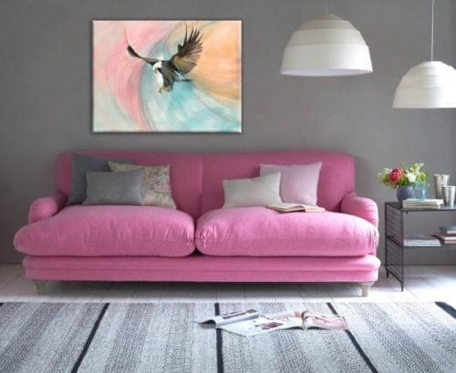 Our Strength and Beauty limited edition giclee print by P Buckley Moss features an American Eagle in flight with full wing span. Multicolored background of soft aqua, peach pink and white.