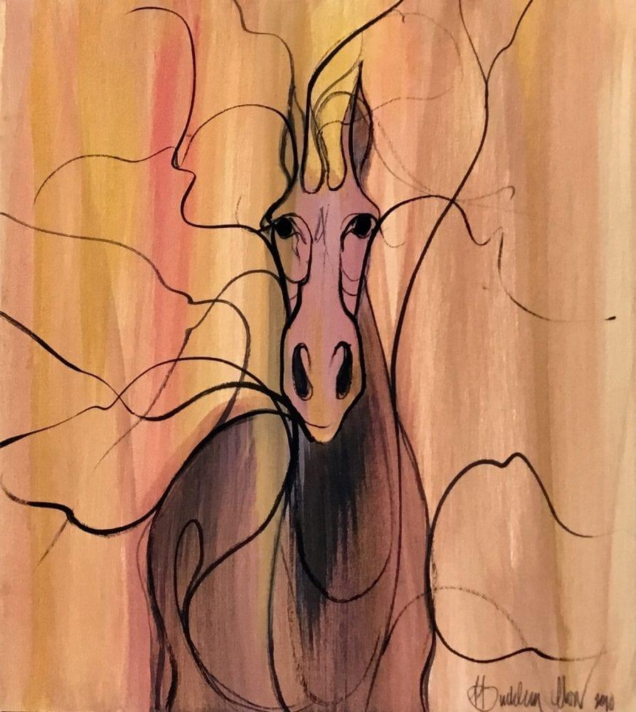 Original watercolor painting by P Buckley Moss featuring her iconic horse with flaring nostrals on a background of peach and a streak of rose. Background featuring random branches as if the horse is emerging from a wooded area.