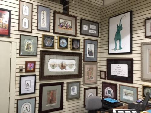 Gallery wall at Canada Goose Gallery in Waynesville Ohio featuring the artwork of P Buckley Moss.