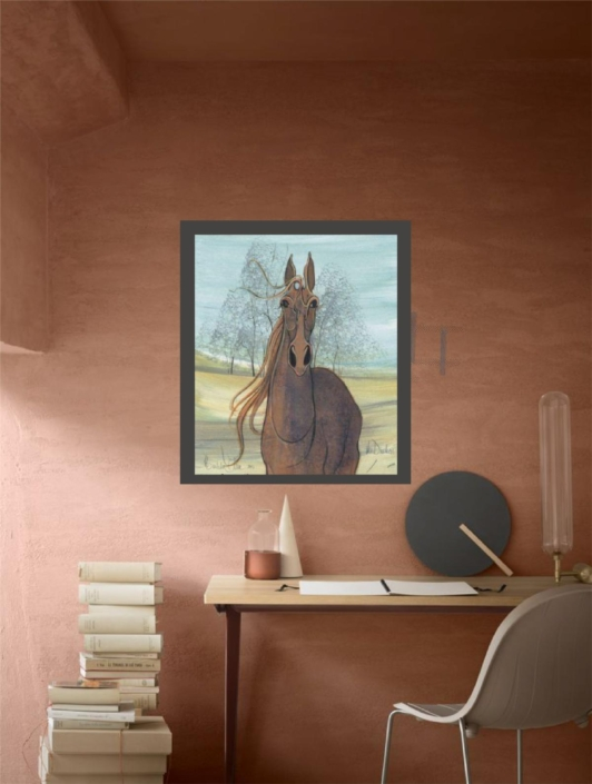 Office spaces decorated with the art of P Buckley Moss. Duchess horse limited edition print in colors of rust for the horse and a blue background with highlights of yellow and earth tones.