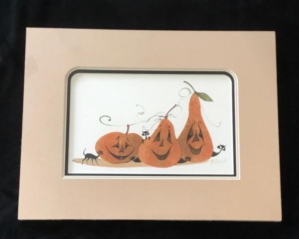 Matted Getting in the Spirit print by P Buckley Moss. Orange Pumpkins with peach colored matting, black mat on the bottom