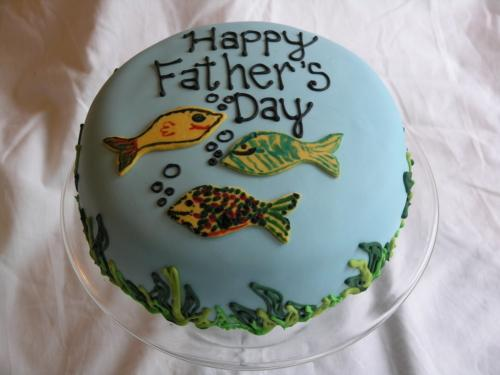 Special cake for Father's Day or anytime you feel like making dad feel special. Fishing theme with different colors of fish on a water colored background with seaweed added of course.
