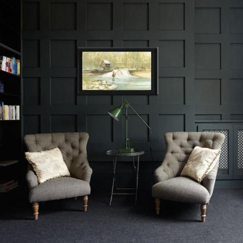 Home decor setting with the artwork of P Buckley Moss. The River's Joy limited edition print. Features a man fishing in a river with pant legs rolled, in a background of the view of the river's edge.