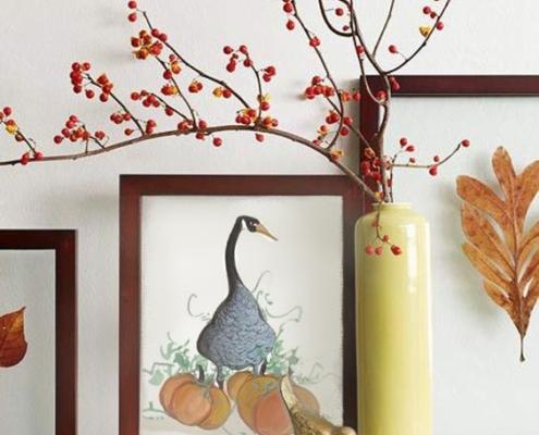 P Buckley Moss Halloween Goose features a blueish goose standing by beautiful pumpkins.