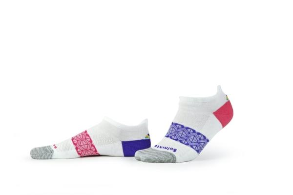 Solmate Performance Sock in white with different color heels.