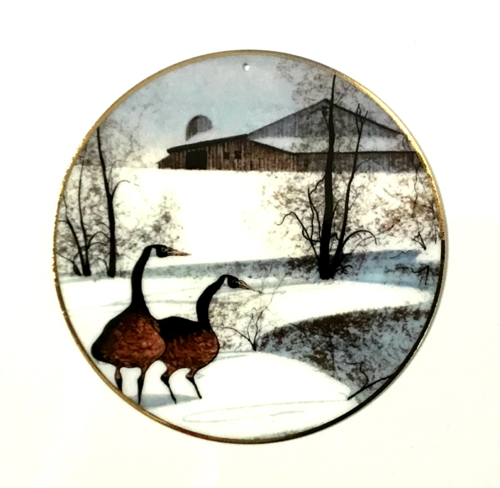Winter Pond ornament by P Buckley Moss features two geese by pond with barn in background.